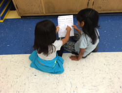 Two young students talking about a story plan