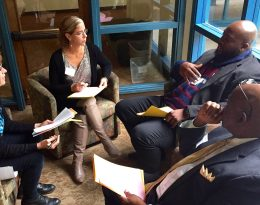 School leaders talk in a group