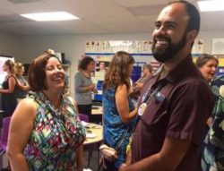 Two teachers laughing together