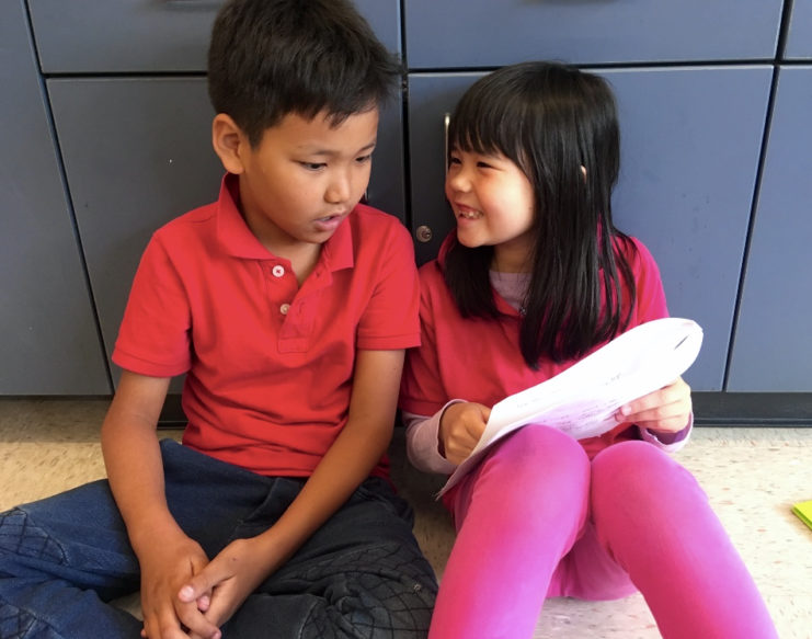 Two students talking about writing
