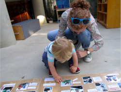 Teacher and toddler with worm book